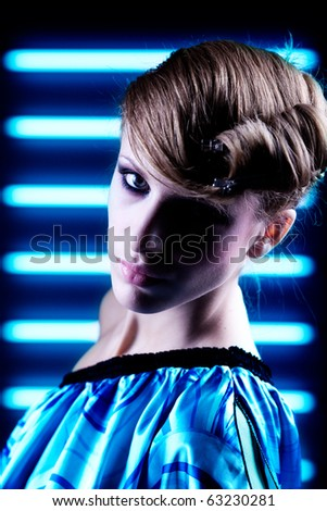 High?fashion,?high?contrast?portrait?on blue?neon?background with styling - stock photo