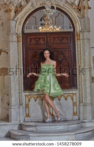 high fashion is in the green short dress.
