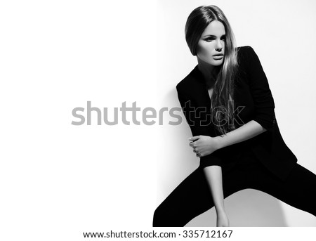 High fashion look.glamor beautiful sexy hot stylish Caucasian young brunette woman model in black hipster clothes posing near white wall #335712167