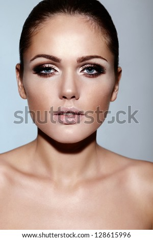 High fashion look.glamor closeup portrait of beautiful sexy Caucasian brunette young woman model with bright makeup with perfect clean skin