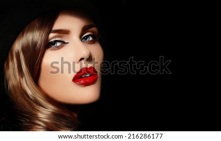High fashion look.glamor closeup portrait of beautiful sexy stylish Caucasian young woman model with bright makeup, with red lips, with perfect clean skin