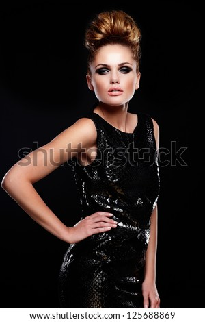 High fashion look.glamor portrait of beautiful sexy stylish Caucasian young woman female model in black dress with bright makeup and hairstyle