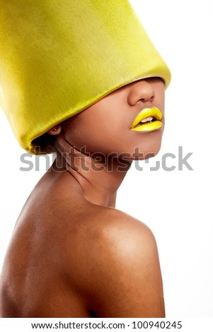High fashion look.glamour fashion beautiful black American woman with yellow bright lips with yellow material on head isolated on white
