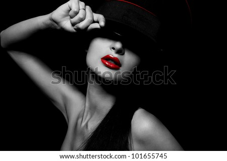 High fashion look.glamour portrait of beautiful sexy young female woman with red lips on black background with hat #101655745