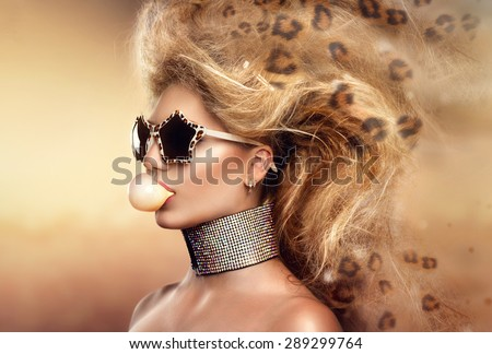 High Fashion Model Girl Portrait wearing sunglasses. Beauty Woman with Holiday Leopard Makeup, Beautiful accessories. Modern updo hair style. Bubble Gum