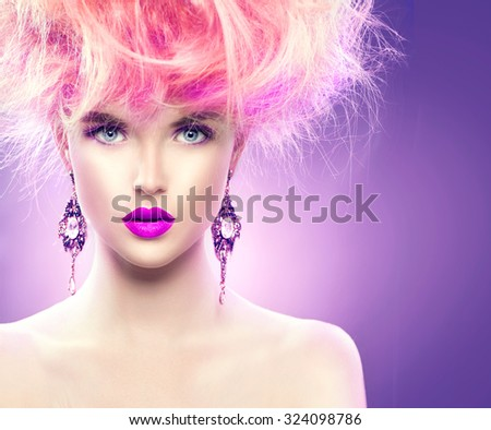 High Fashion Model Girl with pink color Updo hairstyle and bright make up. Beauty woman with glamour hairdo hair style, stylish makeup and accessories. Beauty Lady portrait