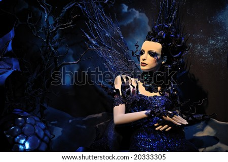 High fashion model in blue dress at a fantasy party