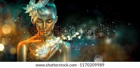 High Fashion model woman in colorful bright golden sparkles and neon lights posing with fantasy flower, portrait of beautiful girl glowing make-up. Art design colorful make up. Glitter Vivid neon skin