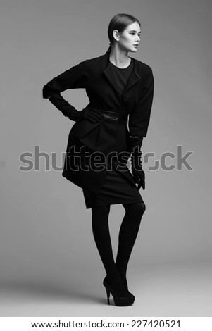 high fashion portrait of elegant woman in black coat.  Black and White image