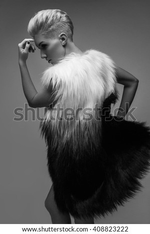 High fashion portrait of young elegant woman. Black and white image