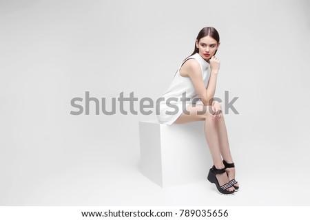 high fashion portrait of young elegant woman. Studio shot  #789035656