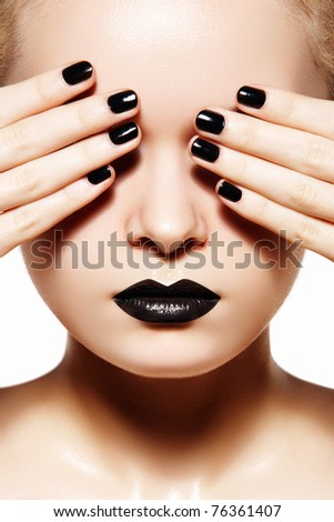 High fashion style, manicure, cosmetics and make-up. Dark lips makeup & nails polish. Close-up portrait of female model with black lipstick, fingernails and gloss skin
