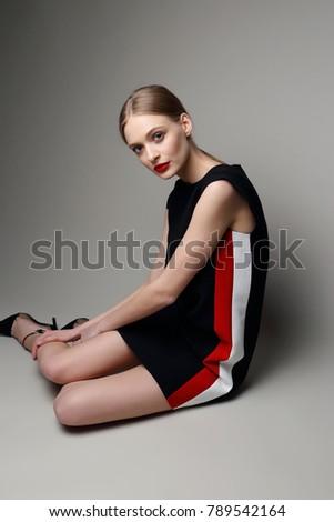 high fashion woman in short black dress. Retro style, studio shot