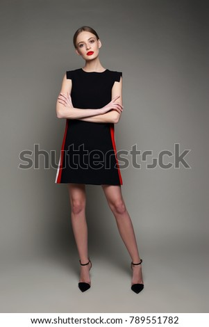 high fashion woman in short black dress. Retro style, studio shot
