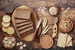 High fibre healthy food concept with wholegrain rye bread, seeded crackers, cereals, grains, buckwheat, barley & seeds. Health food high in antioxidants, omega 3, vitamins and protein with low gi.
