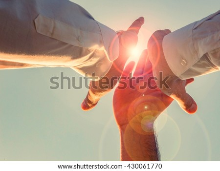 high five threesome in the sun! yes, we can. motivate your employees.
