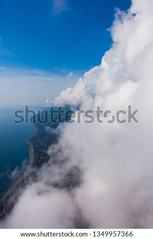 high flight against the wall of clouds over the blue sea view of a paraglider pilot, summer vacation in the Caucasus in Abkhazia. Saturated colors #1349957366