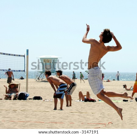 High Flying Serve In Beach Volleyball Match