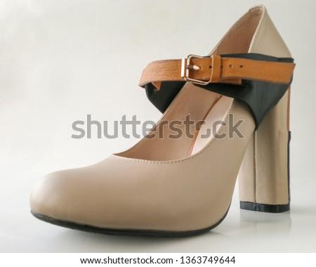High heel footwear on light background. Shallow depth of field. #1363749644