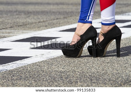 High heel in the start line and pole position on a Grand Prix circuit/High heel in the start line