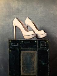 high heel shoes on old speaker in vintage music studio