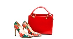 High heel women shoes and a bags. Stylish red women's leather sandals shoes. Woman bag. Ladies bag and stylish red shoes. Colorful leather shoes stiletto. Stylish classic women leather shoe.