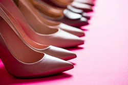 High heel women shoes on red background. Fashionable women shoes isolated on pink background. View from above. Shoe for women. Stylish classic women leather shoe.