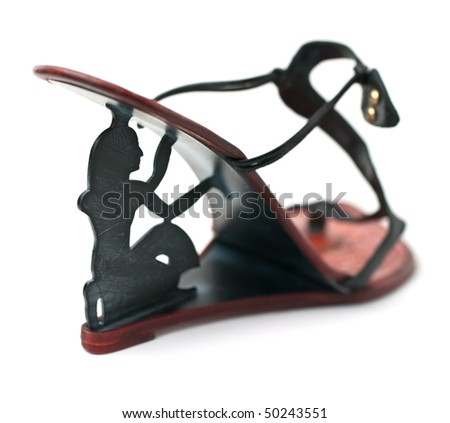 High heels of black shoe consisting of silhouette of a man