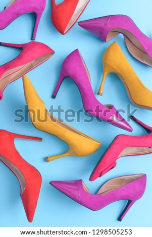 high heels. Top view different colors of high heels isolated pink background. Fashion and beauty concept. Footwear for women    #1298505253