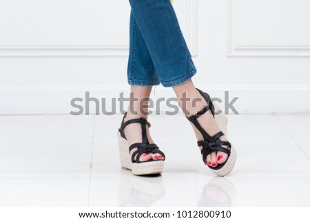 High heels with beautiful legs in a white background