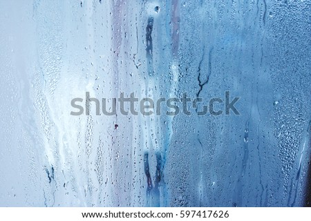 High humidity, natural water drops, window glass with condensation