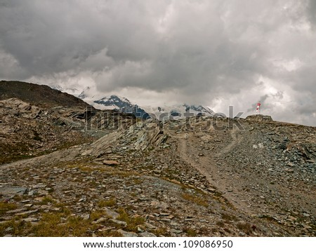 High in the Italian Alps - cloudy, bleak landscape