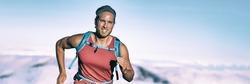 High intensity interval training triathlete man runner running breathing hard sweating on triathlon race endurance workout panoramic banner background.