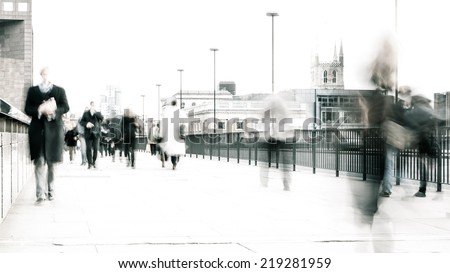 High key, abstract captures of business commuters during early morning London rush hour.  Long exposure creating a motion blur to emulate the movement of the scene.