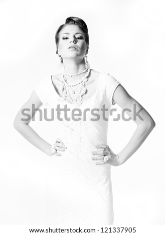 High key black and white studio portrait of young pretty fashion bride model posing �¢?? holding her hands on her waist and looking at camera - stock photo