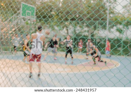 High key blurred image for background of street basketball players on the basketball court work out in the evening