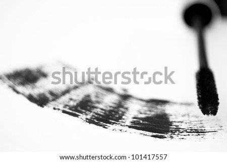 high-key image of mascara brush and stroke