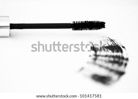 high-key image of mascara brush and stroke