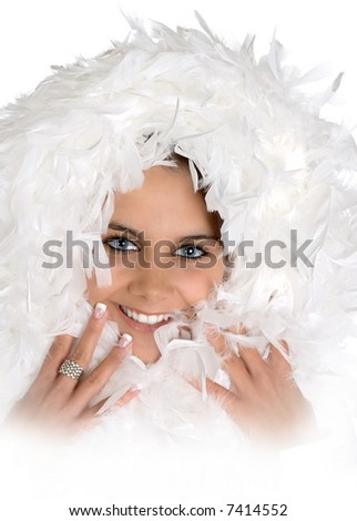 High-key portrait of an attractive young woman with winter feathers