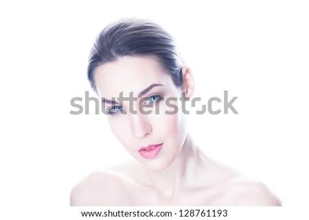 High key portrait of beautiful woman on white background