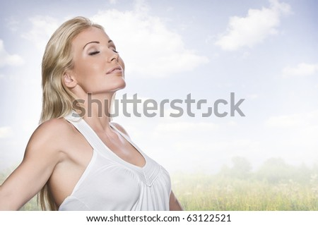 High key portrait of young beautiful woman  in summer environment - stock photo