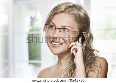 high key portrait of young woman with mobile phone