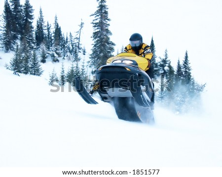 High Key Snowmobile taken a Jump in Snow Сток-фото ©