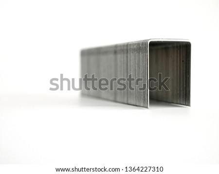 high metal staple for large stapler on white background look like door or tunnel