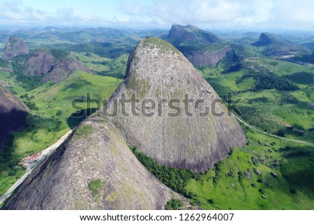 High mountain and rocks in Brazil, aerial view! Beautiful countryside aerial view. Agribusiness, livestock, pasture, cattle. Great landscape. Rural scene. Agriculcure scene. Farm scene. Field scene. #1262964007