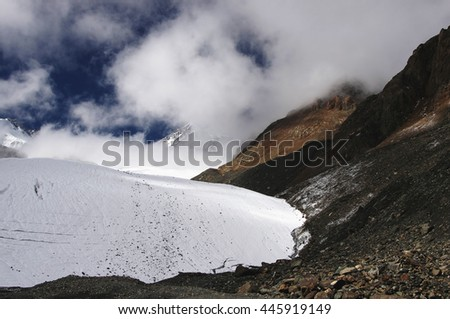 High mountain glacier and snow rocks under the blue sky and white clouds and mist. Aktru, Altai, Siberia, Russia. #445919149