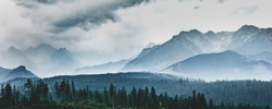 High mountain peaks in clouds and fog. Tatra Mountains, Poland.