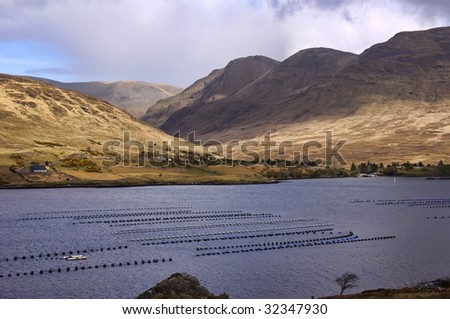 high mountain shot of a fish farm in ireland - stock photo