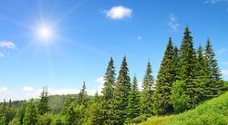 High mountains and sun on blue sky