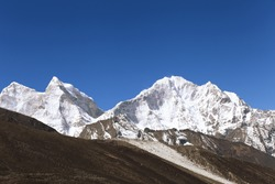 High mountains in cloud. Nepal. Everest region